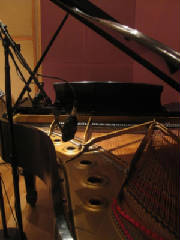photo of piano in recording studio